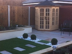 Lawned garden with paving, raised beds and summerhouse
